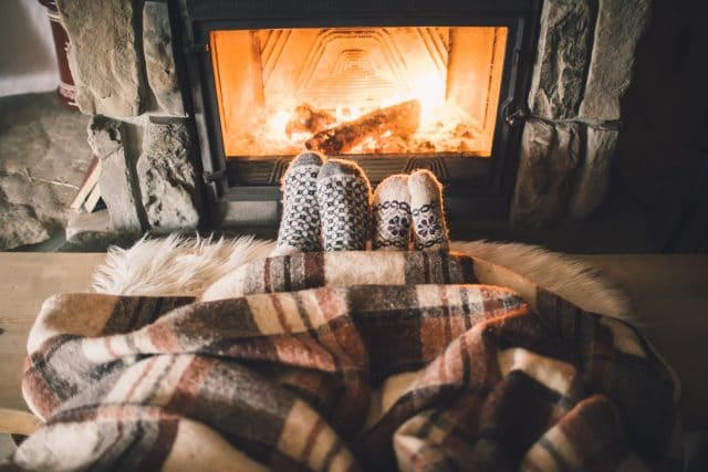 how-to-boost-off-season-bookings-on-your-vacation-rental-website_remarket-cozy-fire