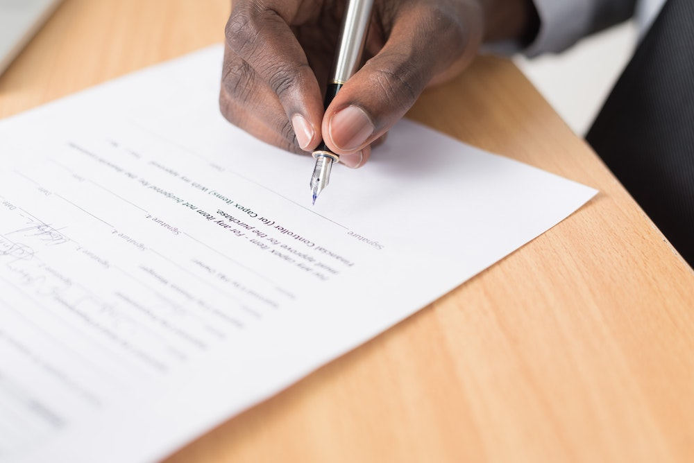 Man signing privacy policy for vacation rental